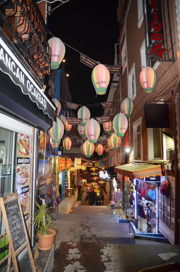 Street with old wooden houses in Fatih district in Istanbul. Night view stock photos