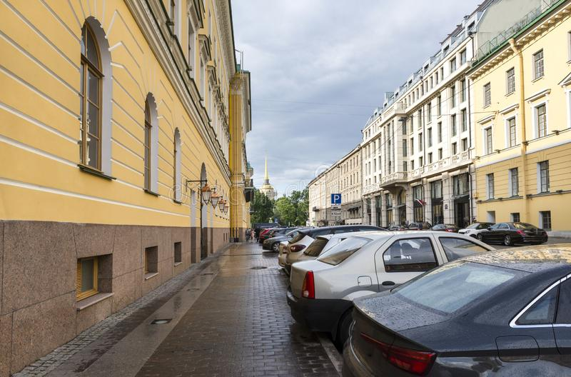 Street with parked cars in St. Petersburg, the building in the classical style. Street with parked cars in St. Petersburg, buildings in the classical style, the stock image