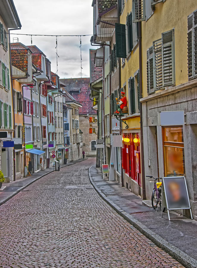 Street with paved road in Old City of Solothurn royalty free stock image