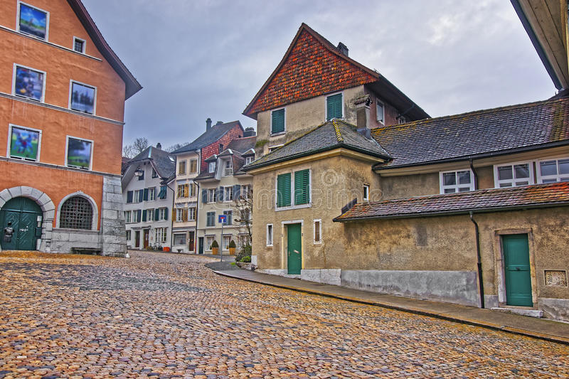 Street with paved road in Old Town of Solothurn royalty free stock photography