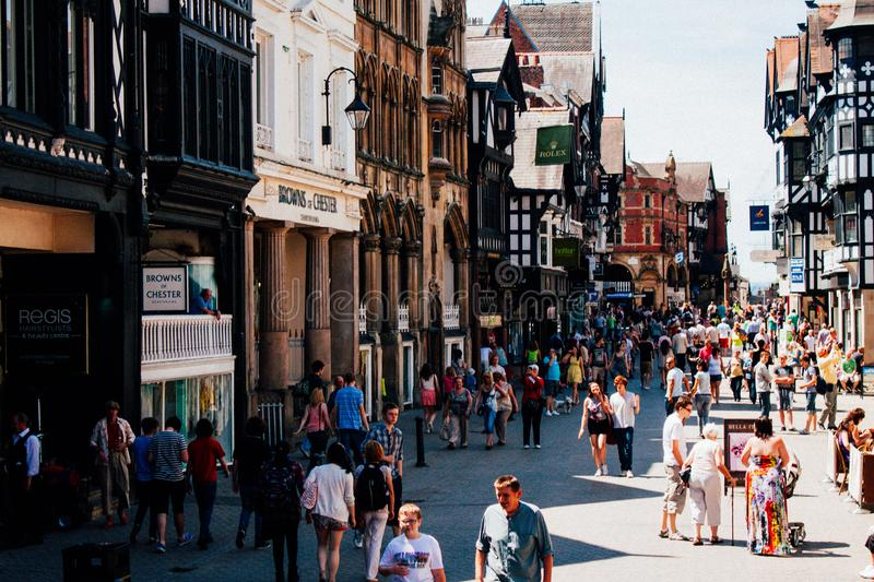 People in the central souvenir street are being bought gifts on a sunny day in England stock photos