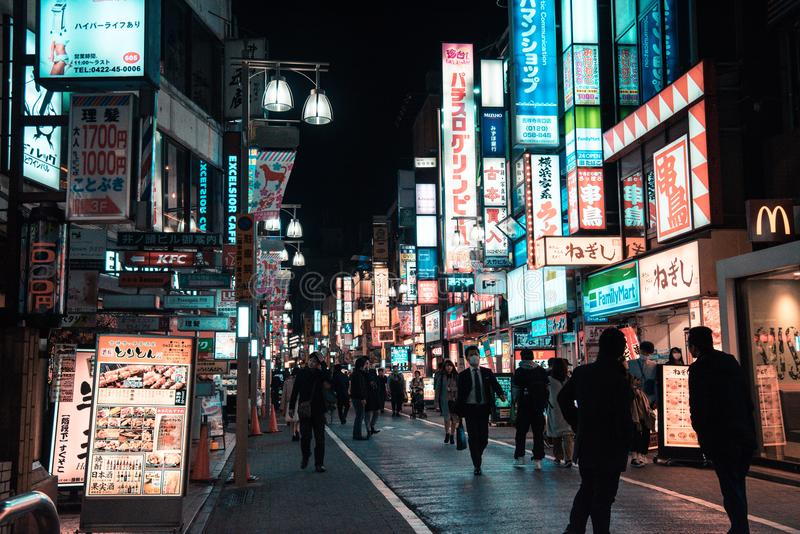 Street With People Walking during Night stock photos