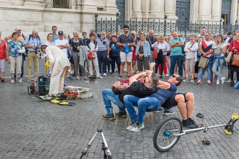 Street performance with the participation of comedian and ordinary people in Piazza Navona in Rome. Italy royalty free stock photo