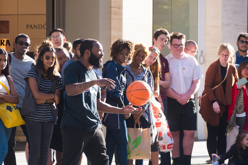 Street performer with basketball in front of crowd stock photos