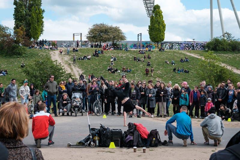 Street performer group dancing breakdance in crowded park Mauerpark in Berlin. Berlin, Germany - May, 2019: Street performer group dancing breakdance in crowded stock image