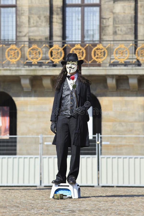 Street performer with Vendetta mask royalty free stock photos