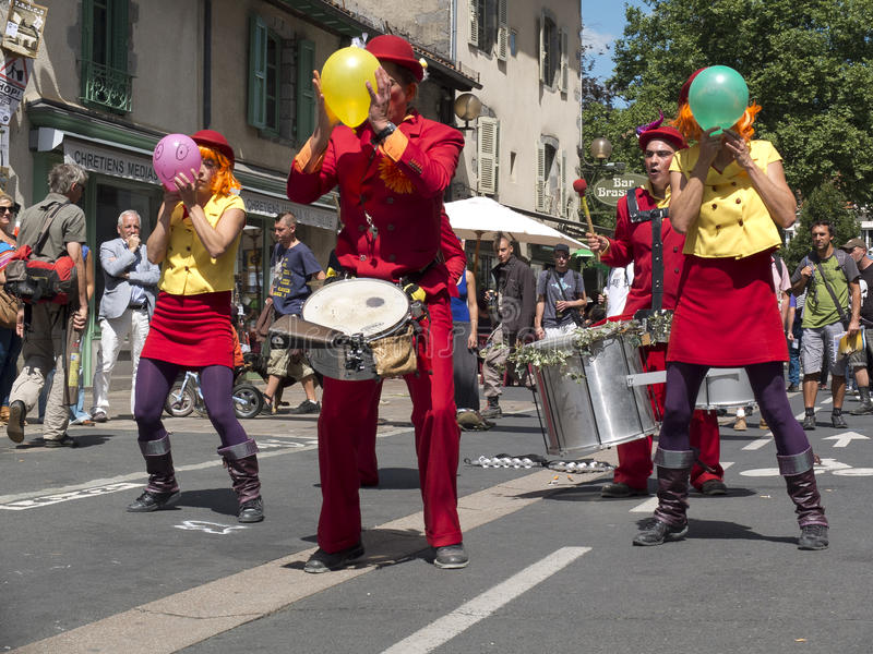 Street performers inflate colored balloons. royalty free stock photo