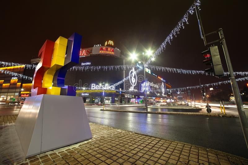 Bucharest downtown - Christmas theme lighting. Street photo in Union / Unirii Square in BucharestnChristmas light decorationsnAnniversary edition 555 years of royalty free stock images