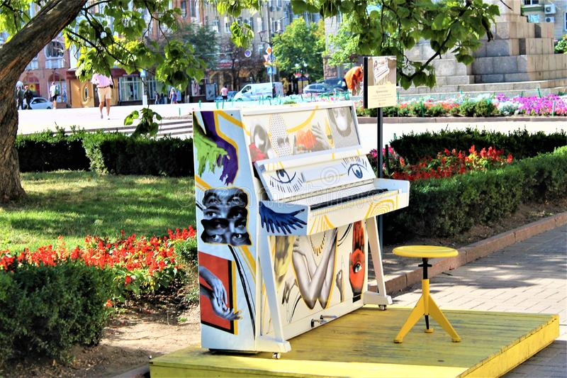 Street piano painted in all colors of the rainbow stock photos