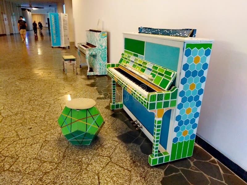 Street pianos at University Hall, Singapore royalty free stock photo