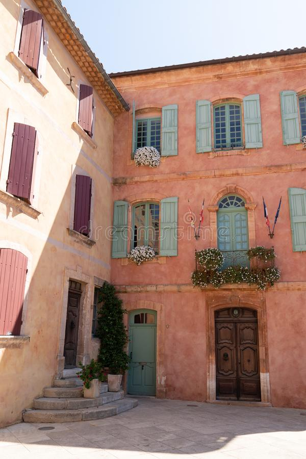 Street place in the old town ocher colors of Roussillon Provence in France royalty free stock photography
