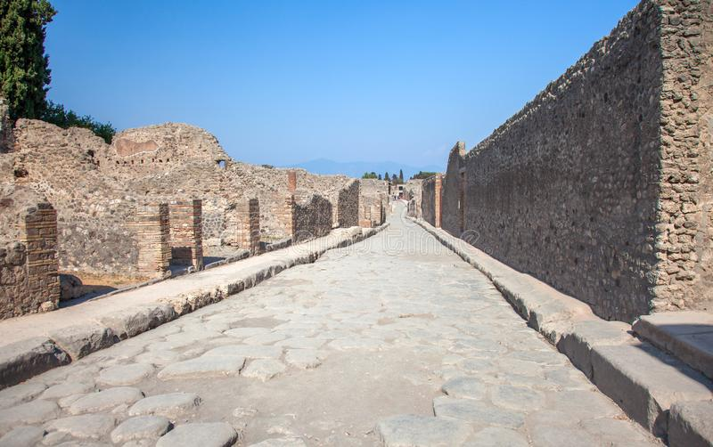 Street in Pompeii and Vesuvius, Italy royalty free stock photography