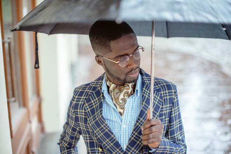 Urban portrait of handsome African American businessman standing royalty free stock photo