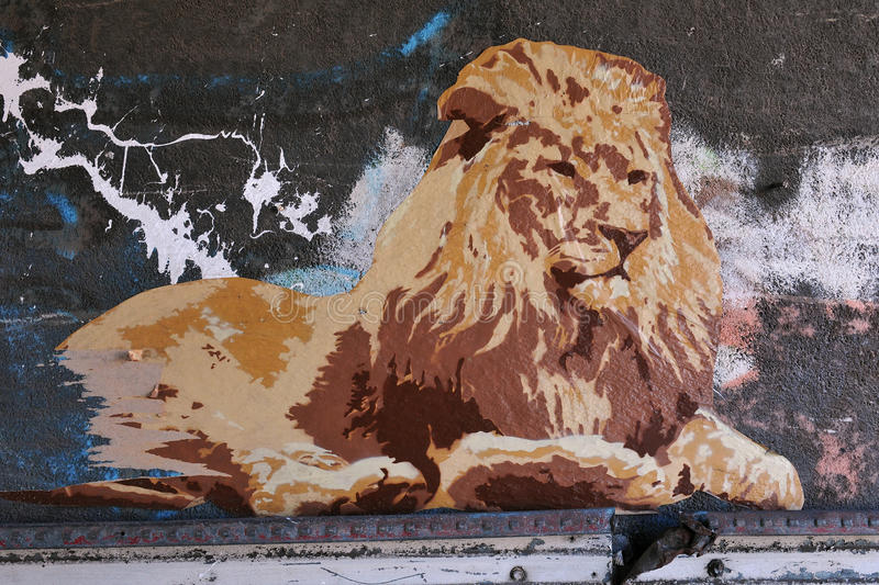 Street Poster Art of a Lion. BRISTOL - NOVEMBER 8: Street poster art piece by an unidentified artist on a wall in the Stokes Croft area of the city on November 8 royalty free stock photography