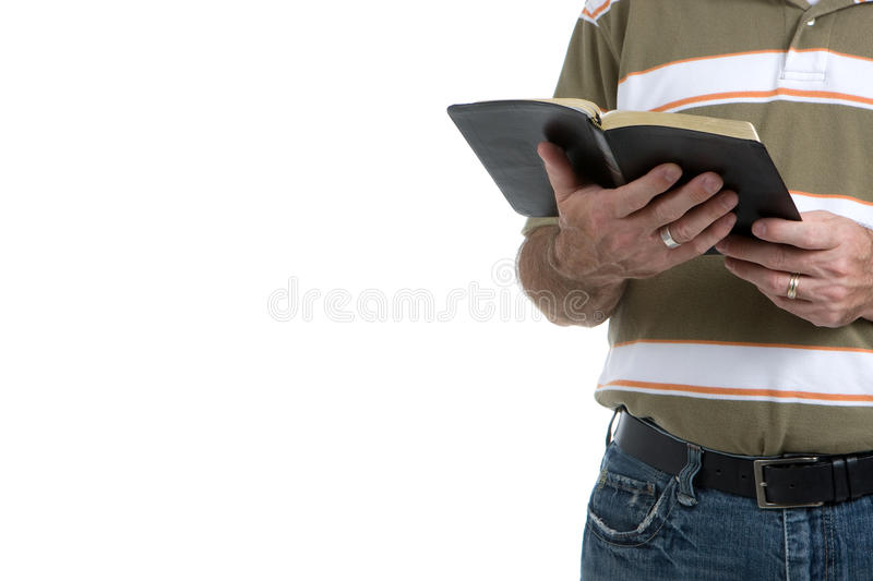 Street Preacher. Holds his open bible wearing jeans and a sports shirt. Isolated with room for copy on left royalty free stock images