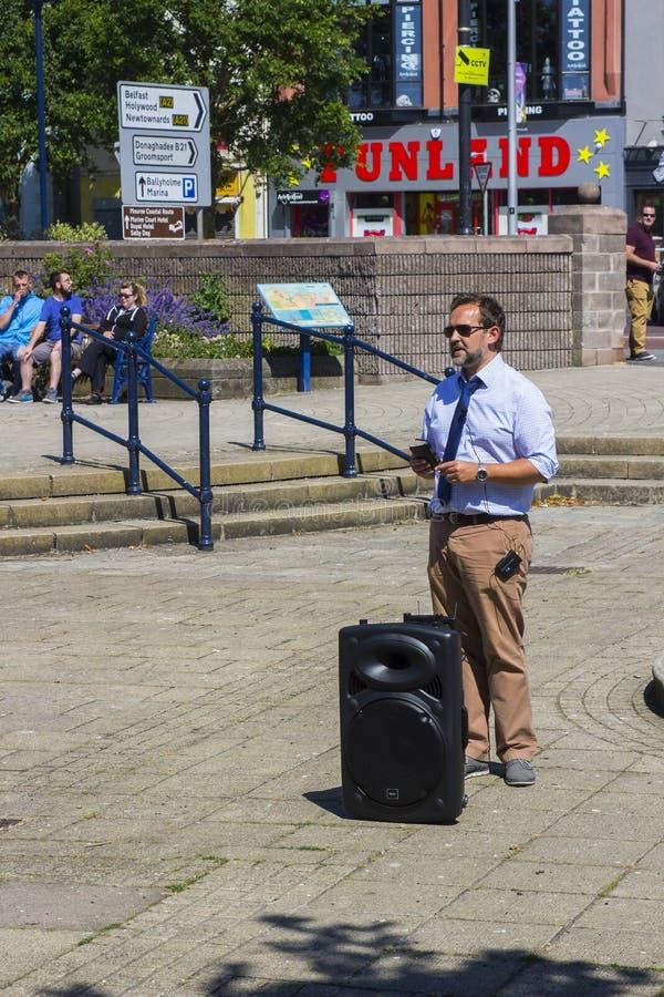 A Street preacher. Preaching the good news of salvation through faith alone in Jesus Christ in the Sunken Gardens Bangor Co Down. 2 July 2018 A Street preacher stock image