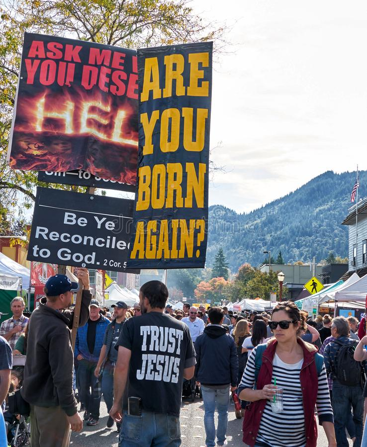 Street preachers carring signs to repent stock photos