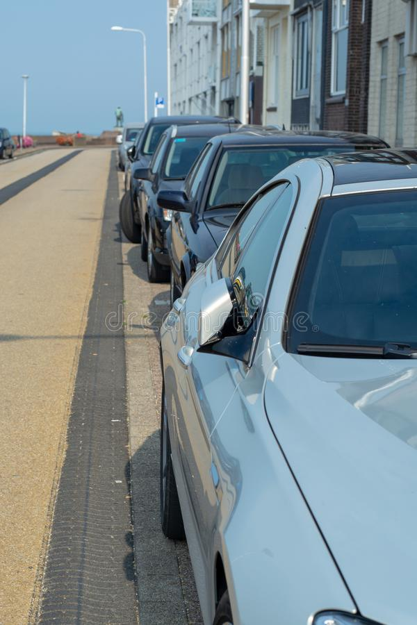 Street public parking along the road in small Dutch city. Street public parking along road in small Dutch city stock image