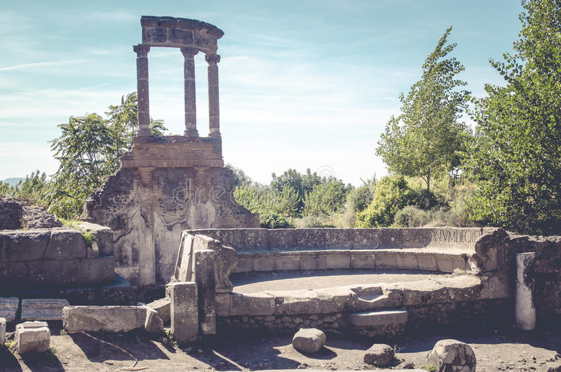 the street with remains of roman buildings in pompeii italy. stock photo