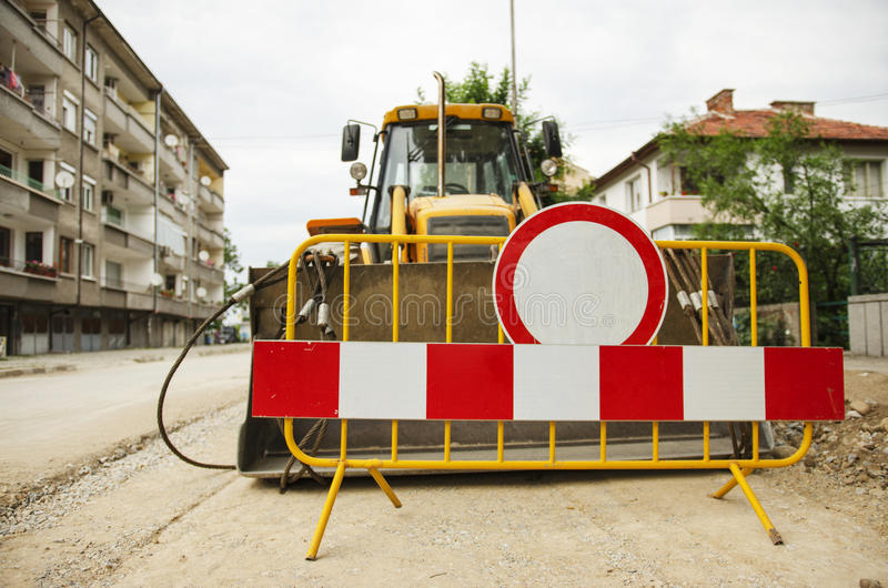 Street Renovation With Big Industrial Excavator royalty free stock photo