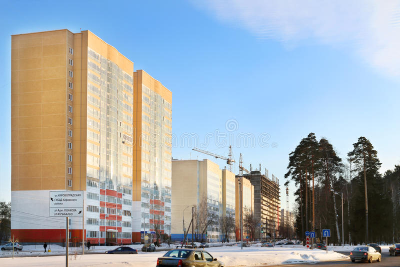 Street with residential buildings and cars. On road at winter in Perm, Russia. Text on sign Kirovogradskaya, Ushakova, Ribalko st., traffic police royalty free stock photography