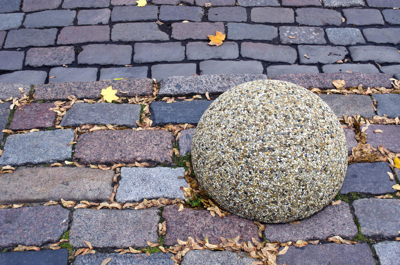 Street road brick background and granite ball royalty free stock photos