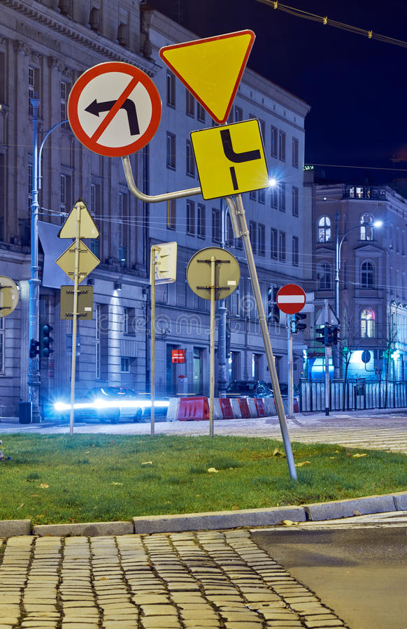 Street and road signs at night. In Poznan stock image