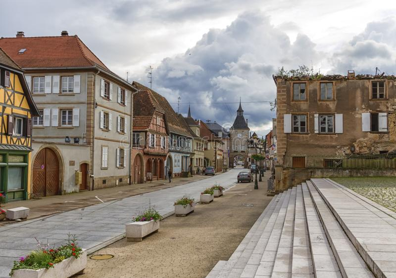 Street in Rosheim, Alsace, France. Street and historic gate in Rosheim, Alsace, France stock photography