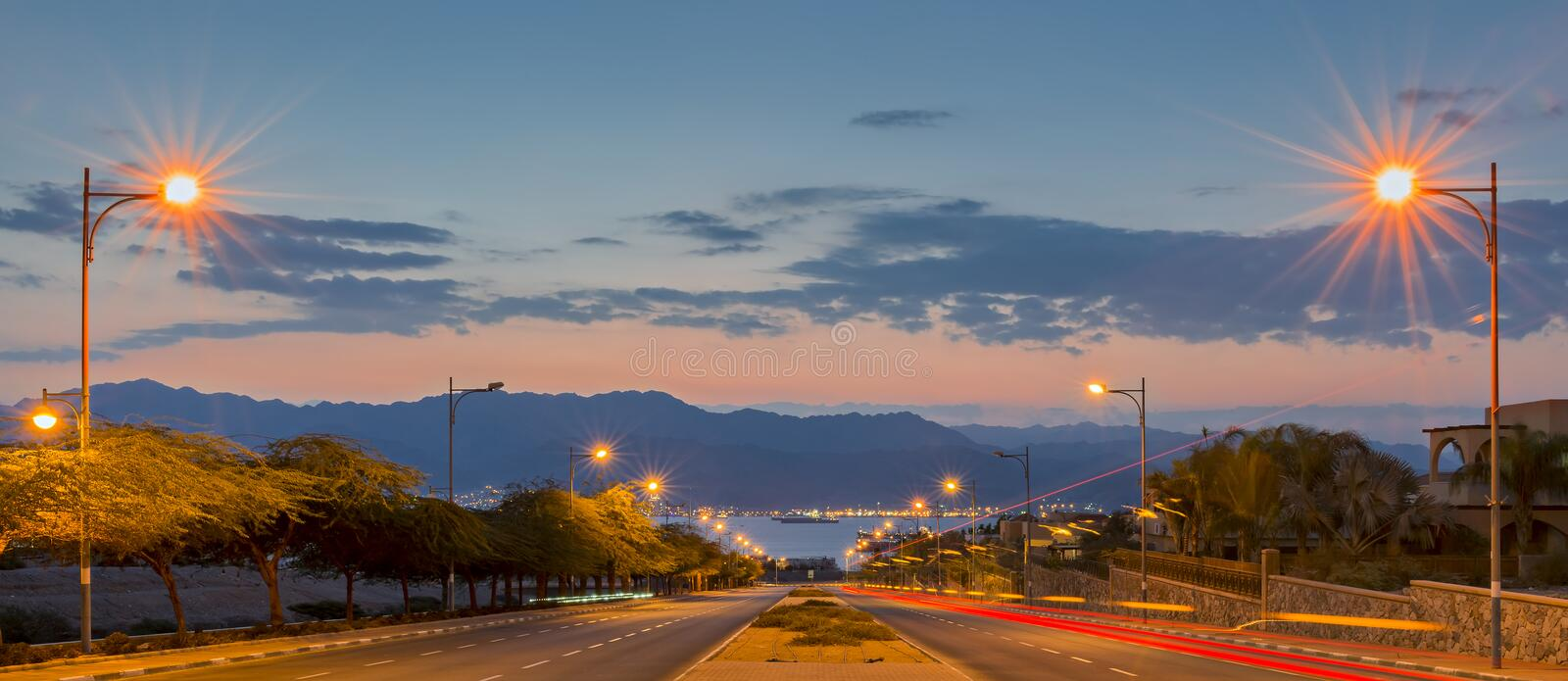 Street runnung to the Red Sea in Eilat - famous resort city of Israel. Eilat is a perfect vacation spot suitable for the perfect blend of fun, sun, diving, water stock image