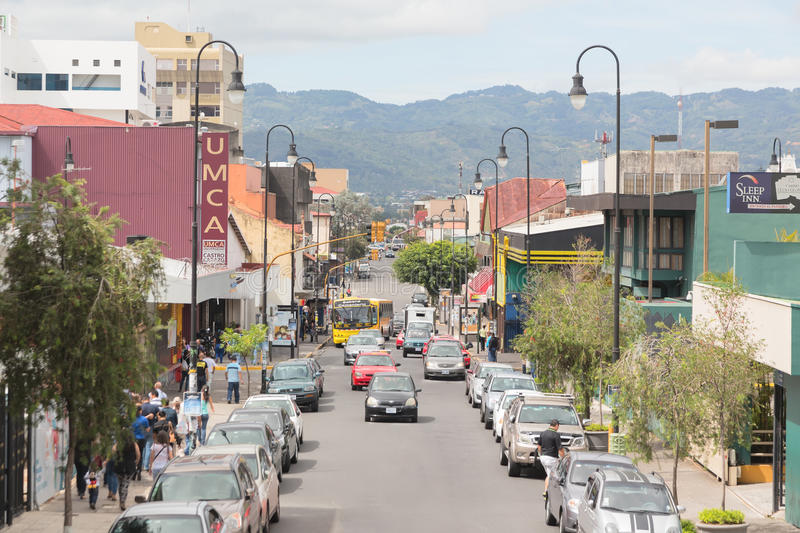 Street in San Jose downtown, Costa Rica. SAN JOSE, COSTA RICA - MAY 17: Panoramic view one of the busiest streets in San Jose downtown, Costa Rica royalty free stock photography