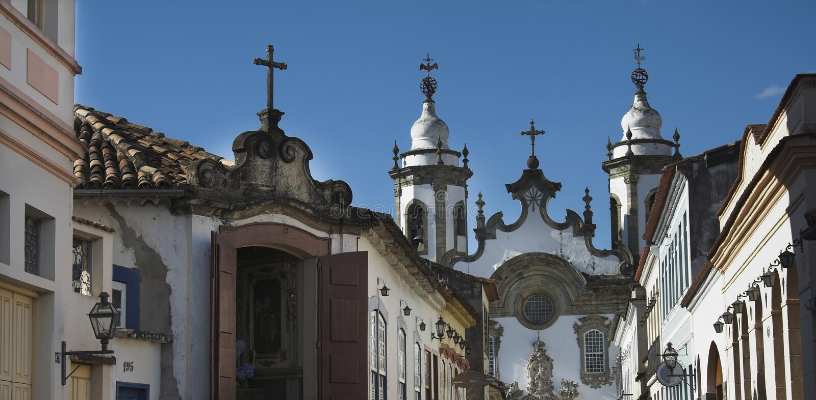 Street in Sao Joao del Rey. A typical street in Sao Joao del Rey with a church in the back. Some baroque housing and a chapel in this historical city. Minas royalty free stock photos