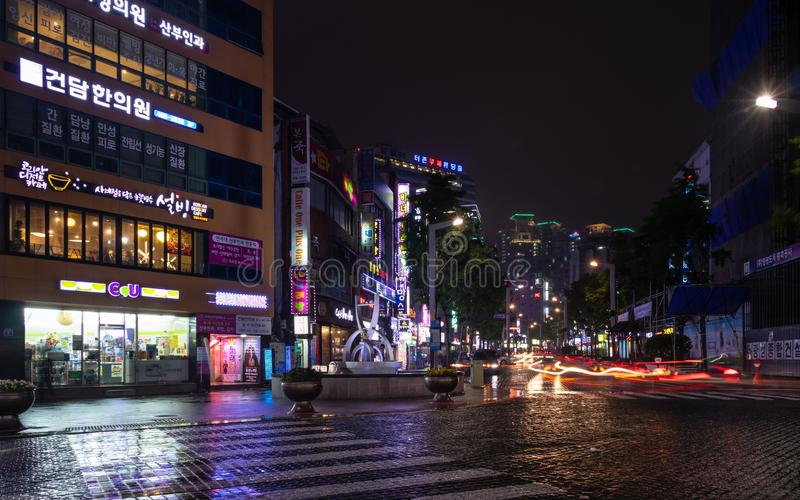 Street Scenario with Buildings, Central Square and traffic lights during Night of Busanjin District, Busan, South Korea. Asia. Street Scenario with Buildings stock photo