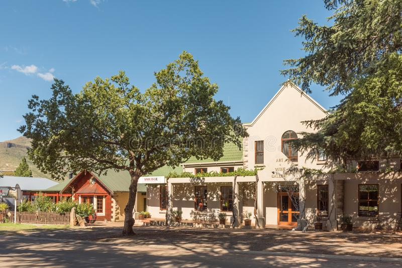 Street scene with an art and wine gallery in Clarens stock image