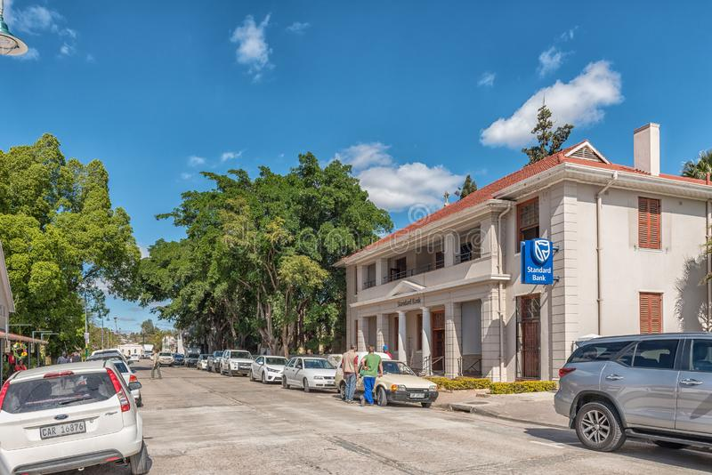 Street scene, with a bank, people and vehicles, in Clanwilliam. CLANWILLIAM, SOUTH AFRICA, AUGUST 22, 2018: A street scene, with a bank, people and vehicles, in royalty free stock photography