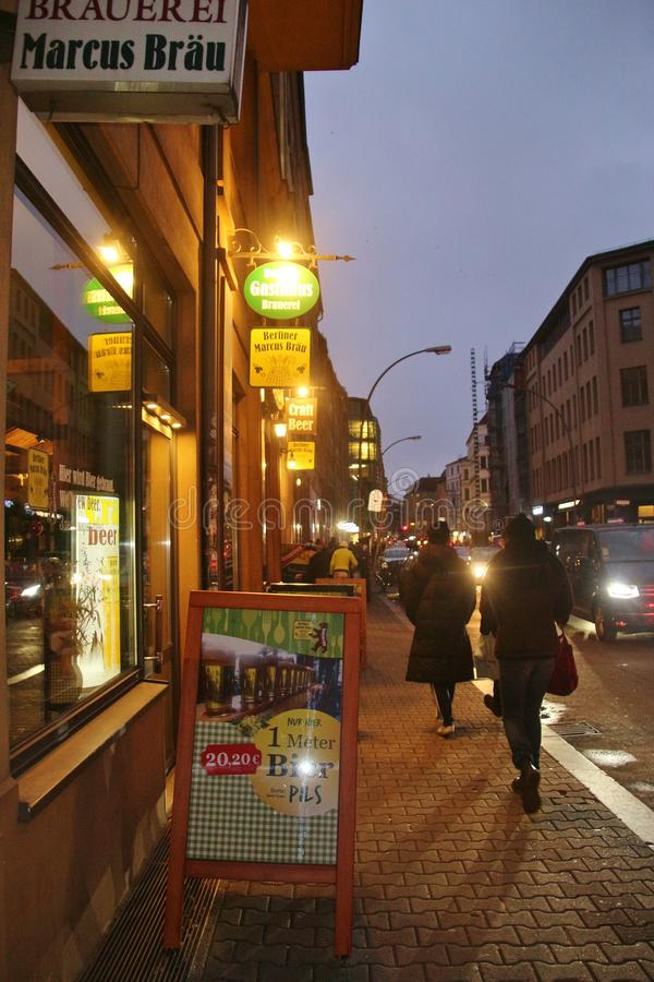 Street scene in Berlin, next to Alexanderplatz square, on a winter evening. Germany. stock photography