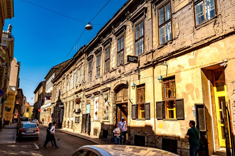 Street Scene in Budapest, Hungary. BUDAPEST, HUNGARY - CIRCA APRIL 2019: View on the famous ruined Pubs Instant, Fogashaz, Robot and Mazel Tov in the famous stock photos