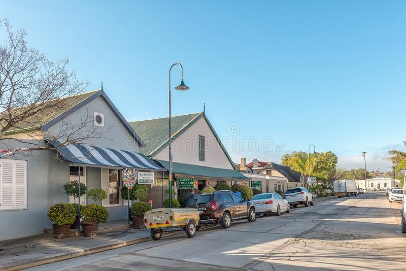 Street scene, with businesses, vehicles and people, in Clanwilliam. CLANWILLIAM, SOUTH AFRICA, AUGUST 28, 2018: A street scene, with businesses, vehicles and stock image