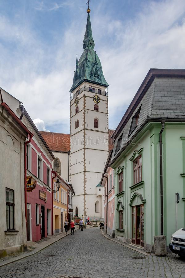Street scene with church in Bohemia stock images