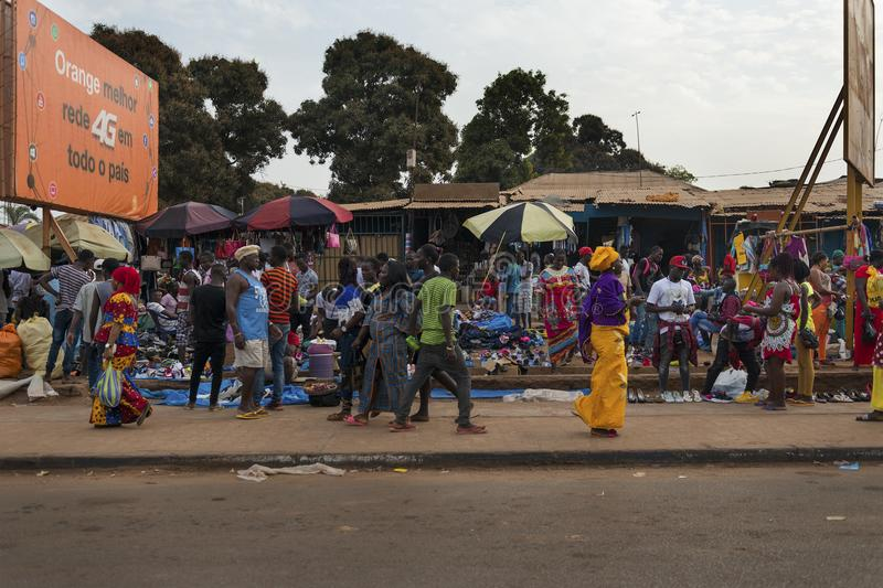 Street scene in the city of Bissau with people at the Bandim Market, in Guinea-Bissau. Bissau, Republic of Guinea-Bissau - January 28, 2018: Street scene in the royalty free stock photos