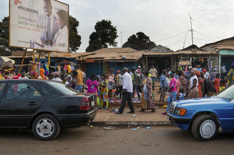 Street scene in the city of Bissau with people at the Bandim Market, in Guinea-Bissau. Bissau, Republic of Guinea-Bissau - January 28, 2018: Street scene in the stock image