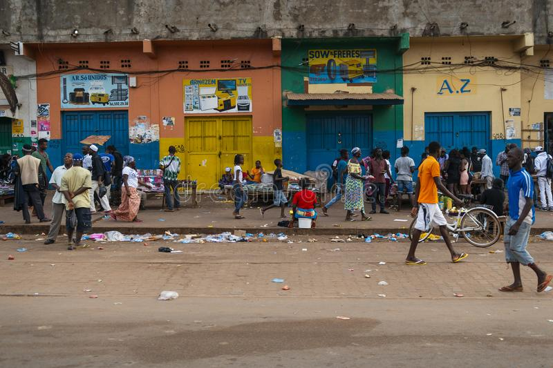 Street scene in the city of Bissau with people at the Bandim Market, in Guinea-Bissau. Bissau, Republic of Guinea-Bissau - January 28, 2018: Street scene in the royalty free stock photo