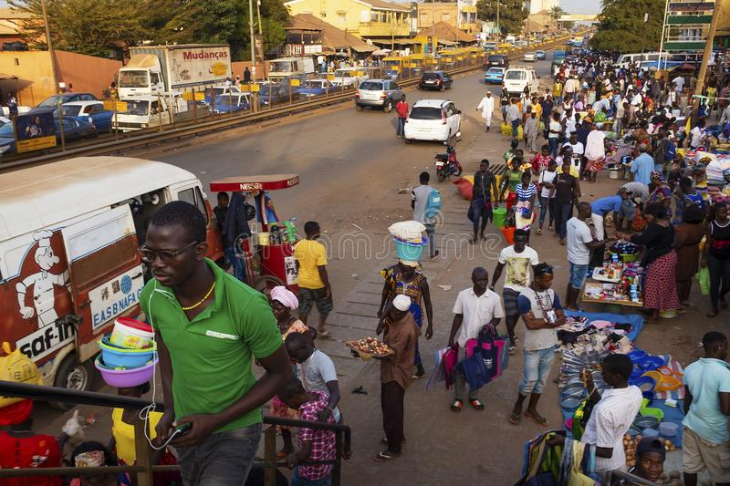 Street scene in the city of Bissau with people at the Bandim Market, in Guinea-Bissau. Bissau, Republic of Guinea-Bissau - January 30, 2018: Street scene in the royalty free stock images