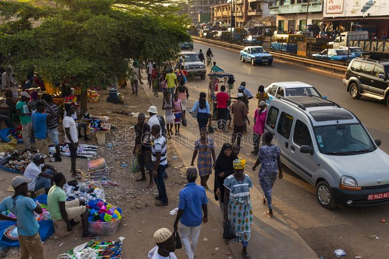 Street scene in the city of Bissau with people at the Bandim Market, in Guinea-Bissau, West Africa. Bissau, Republic of Guinea-Bissau - January 30, 2018: Street royalty free stock photos