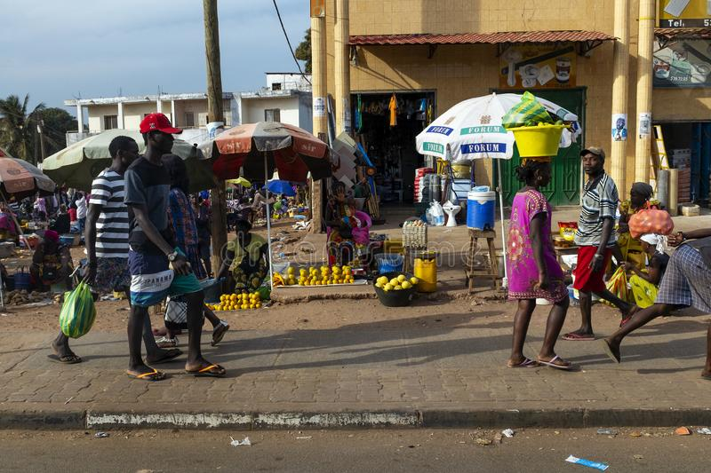 Street scene in the city of Bissau with people at the Bandim Market, in Guinea-Bissau, West Africa. Bissau, Republic of Guinea-Bissau - February 8, 2018: Street royalty free stock image