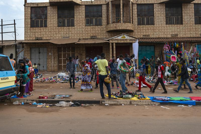 Street scene in the city of Bissau with people at the Bandim Market, in Guinea-Bissau. Bissau, Republic of Guinea-Bissau - January 28, 2018: Street scene in the royalty free stock photography
