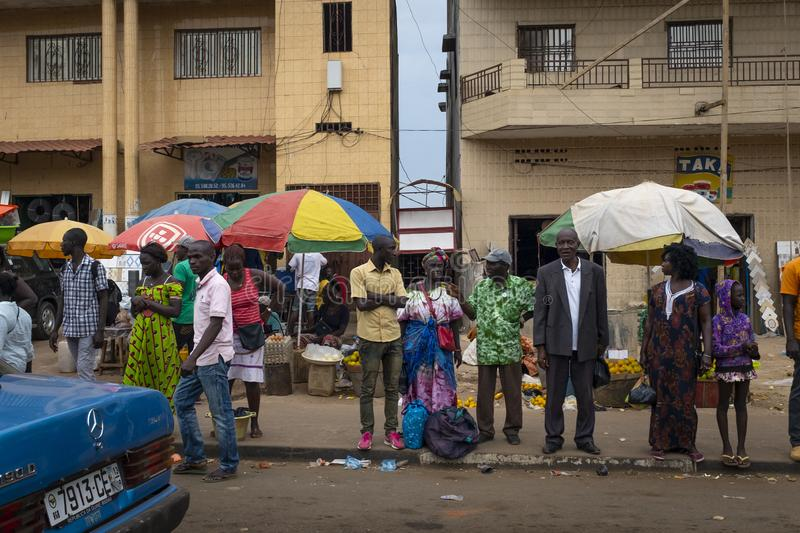 Street scene in the city of Bissau with people at the Bandim Market, in Guinea-Bissau, West Africa. Bissau, Republic of Guinea-Bissau - February 6, 2018: Street stock photos