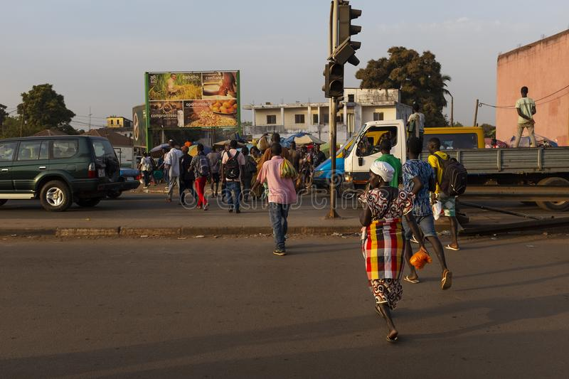 Street scene in the city of Bissau with people crossing a road in a crosswalk, near the Bandim Market, in Guinea-Bissau. Bissau, Republic of Guinea-Bissau stock photography