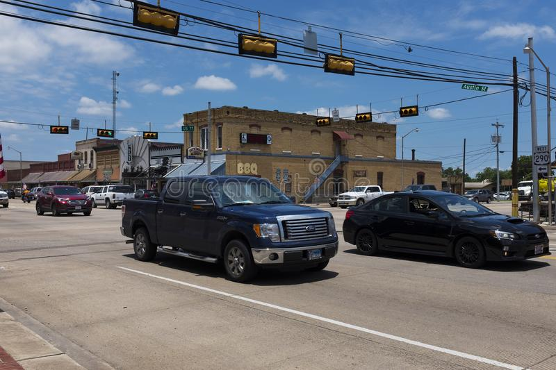 Street scene in the city of Giddings in the intersection of U.S. Highways 77 and 290 in Texas stock photography