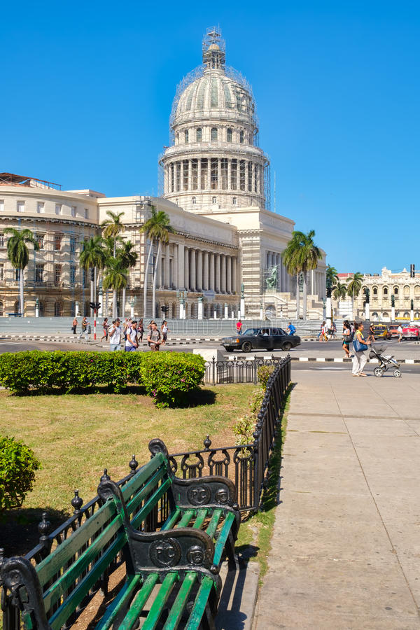 Street scene in downtown Havana with a view of the Capitol building. HAVANA,CUBA - JANUARY 24,2017 : Street scene in downtown Havana with a view of the Capitol royalty free stock photography