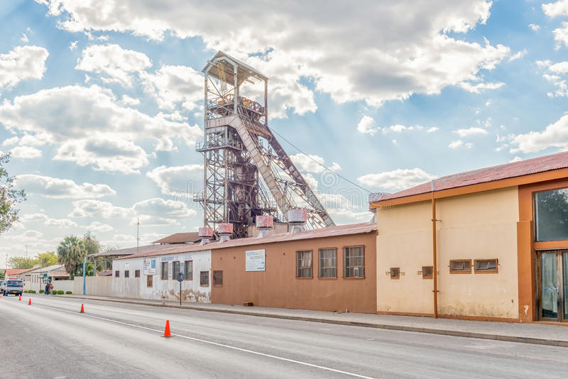 Street scene with the headgear of the mine in Tsumeb stock image